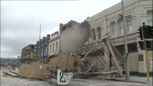 aftermath with damage to central city with collapsed chinese acupuncture building and smoke pouring from old two storey building on manchester street - building storey stock videos and b-roll footage