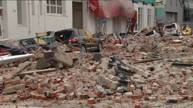 aftermath with rubble and crushed cars on central city streets - カンタベリー点の映像素材/bロール