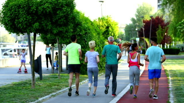 afternoon jogging - active lifestyle stock videos & royalty-free footage