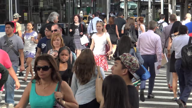 afternoon rush hour, 5th ave, new york city - fifth avenue stock videos and b-roll footage