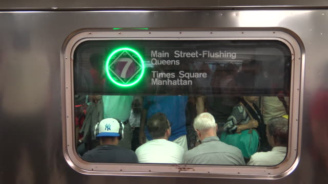 afternoon rush hour via grand central station / subway number 7 train / services operate between main street in flushing, queens and 34th street –... - 34th street stock videos & royalty-free footage