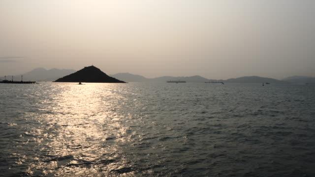 afternoon sky at wavy sea island pier kennedy town hong kong - hong kong island stock videos & royalty-free footage