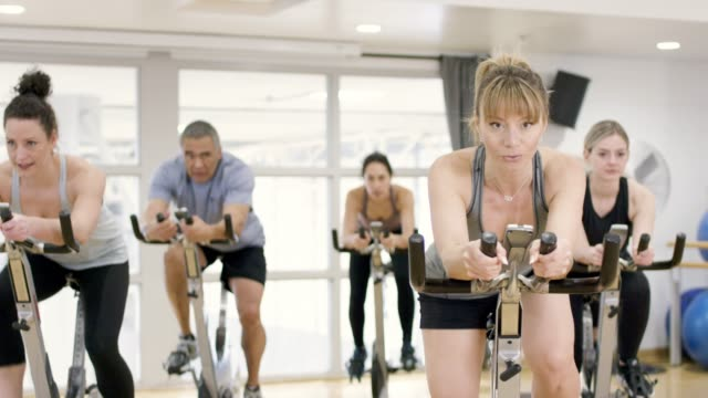 afternoon stationary cycling class - pedal stock videos & royalty-free footage