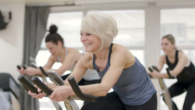 afternoon stationary cycling class - active seniors stock videos & royalty-free footage