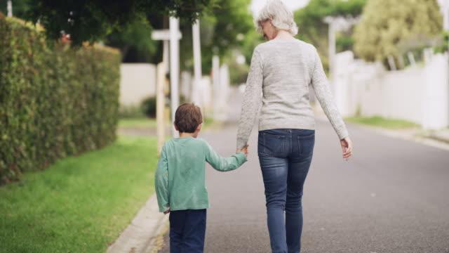 stockvideo's en b-roll-footage met middag wandelingen met mijn kleine boon - grootmoeder