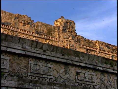 afternoon sunlight illuminates mayan hieroglyphs. - symbol stock videos & royalty-free footage