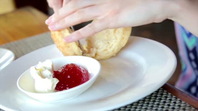 afternoon tea, scone with cream and jam - strawberry jam stock videos & royalty-free footage