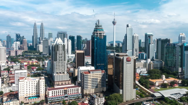 Afternoon Time Lapse at Kuala Lumpur City. Camera pan bottom to top