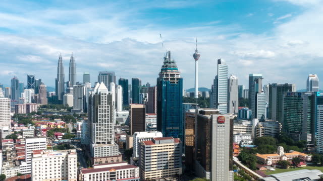 Afternoon Time Lapse at Kuala Lumpur City. Camera Pan top to bottom