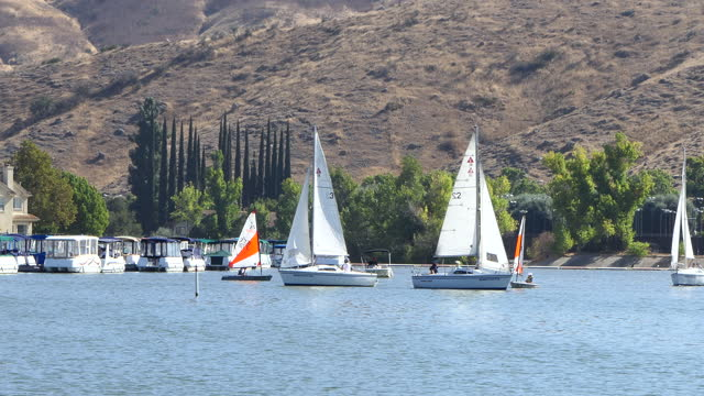 afternoon westlake village lake small catalina 22 sport sailboats racing and small dinghies westlake village a small southern california city in los... - westlake village california stock videos & royalty-free footage