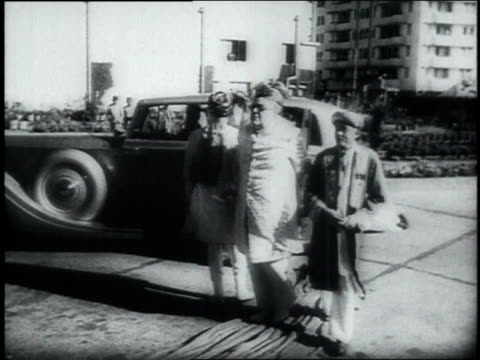 aga khan and party emerging from car / mumbai india - 1946年点の映像素材/bロール