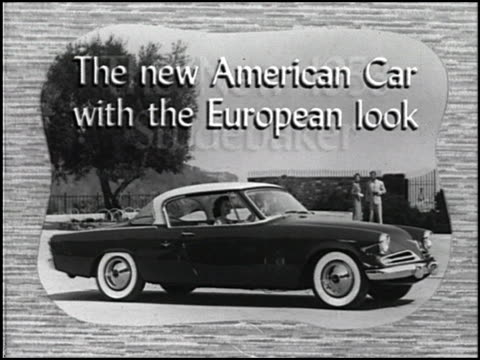 """""""again, studebaker leads the style parade with long, low european lines!"""" exclaims the voiceover. 1950s guy takes his 1950s wife for a ride in their... - south bend indiana stock videos & royalty-free footage"""