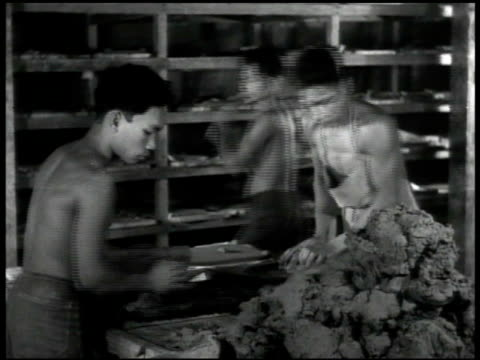 agana tile factory building int chamorro men working w/ clay shaving tiles ext agana soap factory sign int men boxing soap blocks ext service club... - bar of soap stock videos and b-roll footage