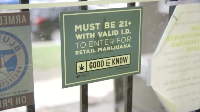 age restriction sign for marijuana retail shop - colorado stock videos & royalty-free footage