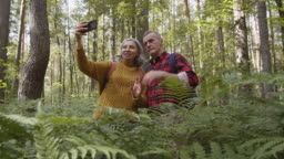 Aged Family Couple Making Selfie Outdoors
