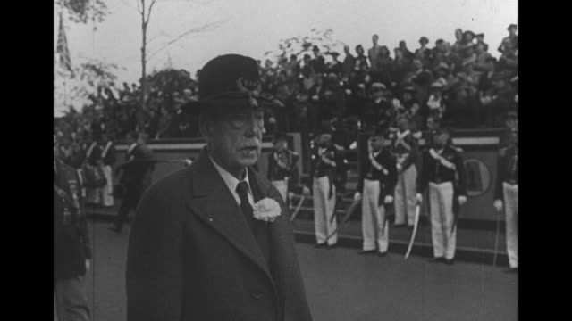 aged men march with uniformed soldiers and grandstands behind another with a boutonniere / low angle view of american flags marching past / note... - boutonniere stock videos and b-roll footage