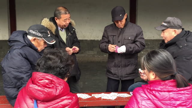 aged people play cards together at famous temple of heaven on feb 20, 2017 in beijing, china. aging of chinese population is a major challenge to... - temple of heaven stock videos & royalty-free footage