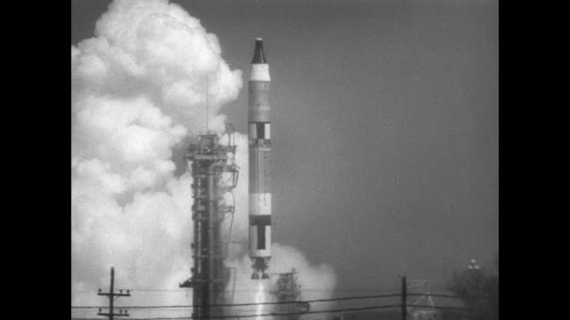 agena rocket atop the atlas on launch pad 14 waiting to launch / small crowd watch as the agena is launched into the sky / int nasa control room /... - abheben aktivität stock-videos und b-roll-filmmaterial