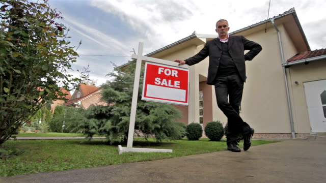 agent for the sale of real estate - selling stock videos & royalty-free footage