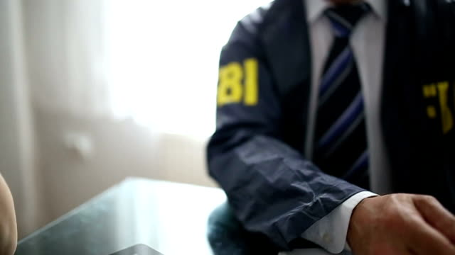fbi agent in the office - fbi stock videos & royalty-free footage