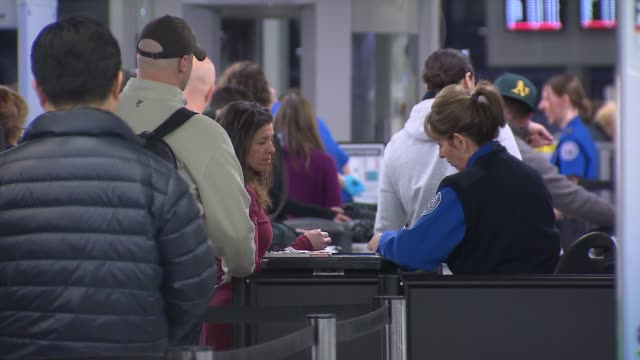 TSA Agent Looking At Passports at Chicago O'Hare Airport on December 13 2013 in Chicago Illinois
