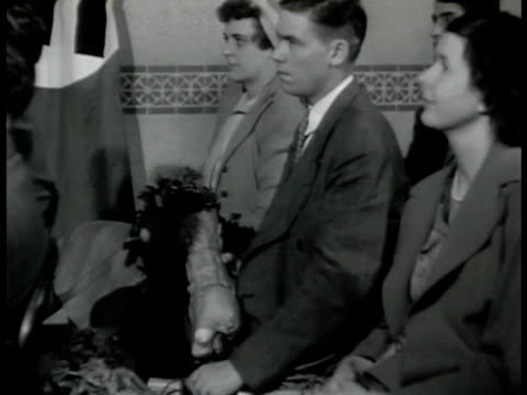 agent sitting at nazi meeting slowly handling bundle of vegetables ms agent listening to meeting cu pulling radio antenna from vegetable la ms... - 1942 stock videos and b-roll footage