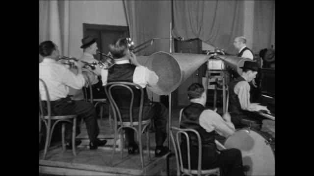 agent writing note 'tiger rag good' cu 1916 telegram 'make recording' victor co sign 'recording room b' int studio vs dixieland jass band recording... - telegram stock videos & royalty-free footage