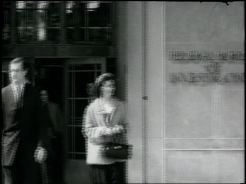 agents and staff members leave one of the federal bureau of investigation buildings at the end of a work day - fbi stock videos & royalty-free footage