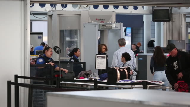 tsa agents and travelers at o'hare international airport in chicago illinois usa on tuesday january 8 2019 - o'hare airport stock videos & royalty-free footage