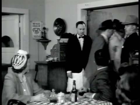 stockvideo's en b-roll-footage met agents arresting 'baumeyer' in restaurant ms special agent in charge telling customers to remain seated ms nazi members out of trapdoor from cellar... - 1942