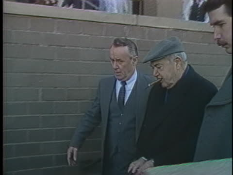 fbi agents escort mobster anthony fat tony salerno out of a courthouse in new rochelle new york after jury selection in his racketeering trial - crime or recreational drug or prison or legal trial video stock e b–roll