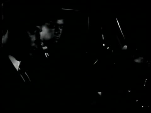 vidéos et rushes de agents in car listening to nazi meeting ms agents in car parked on street int la ms baumeyer amp members nazi saluting 'seig heil' nyc - 1942