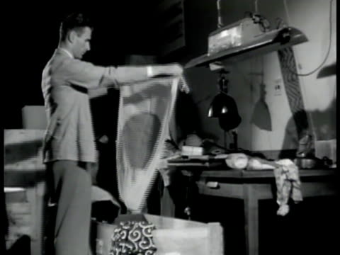 fbi agents looking over confiscated items folding small japanese flag ms confiscated japanese materials ms man unsheathing japanese sword wwii... - 1942 stock videos and b-roll footage