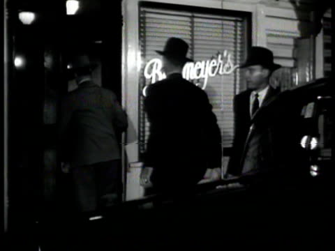 stockvideo's en b-roll-footage met agents pulling up in car entering 'baumeyer's' restaurant int vs undercover agent 'miller' talking w/ special agent in charge ms baumeyer behind... - 1942