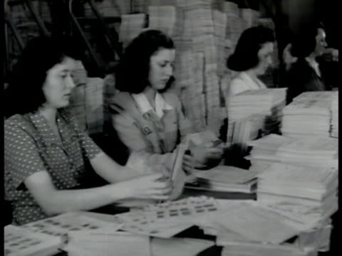 fbi agents working at tables ms women flipping through finger print cards ms finger print cards on desks ms men at letter sorting machine vs men... - 1942 stock videos and b-roll footage