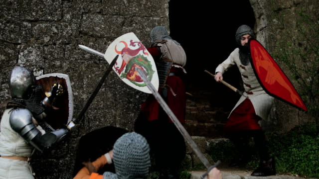 aggressive medieval knights attack the guard - periodo medievale video stock e b–roll