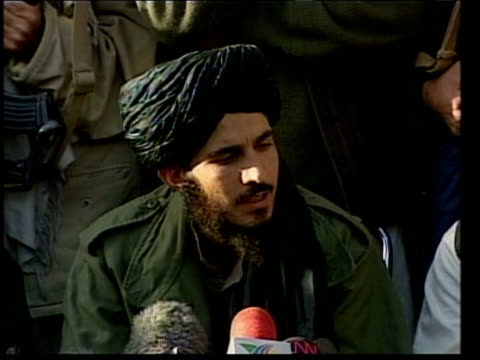 Agha presser SOT We have no idea where he is/ our area is limited now to 3 or 4 provinces/ there is no communication right now CUTAWAY Taliban men