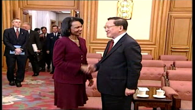 agreement to return to talks on dismantling nuclear weapons china beijing int condoleezza rice walking into hall and shaking hands with tang jiaxuan... - dismantling stock videos and b-roll footage