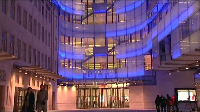 agrees to take on funding of over 75s tv licences; ext / night gv new broadcasting house tilt down to entrance name 'bbc' over entrance to soft focus - soft focus stock videos & royalty-free footage