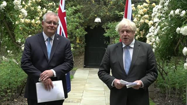agrees trade deal with australia; england: london: 10 downing street garden: ext boris johnson mp press conference - australian pm scott morrison... - australia stock videos & royalty-free footage