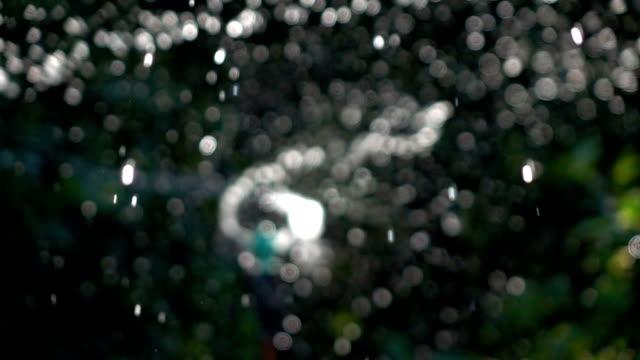agricultural sprinkler, slow motion shot - sprinkler stock videos and b-roll footage