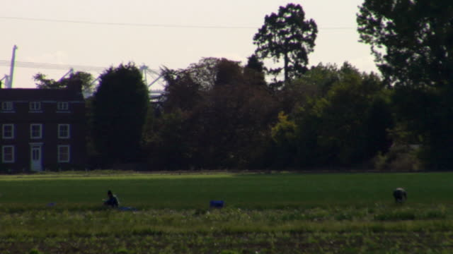 ws pan agricultural sprinkler watering field, rochester, kent, united kingdom - kent england stock videos & royalty-free footage