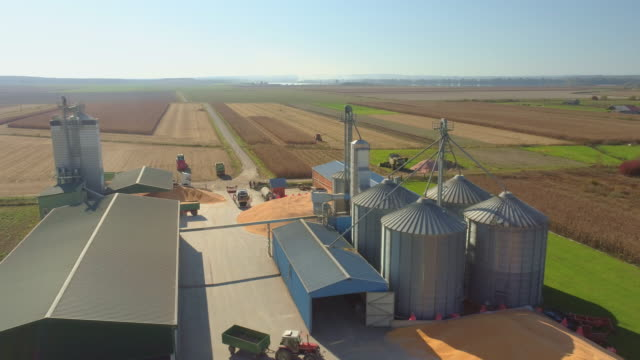aerial agricultural storage facilities - agricultural machinery stock videos & royalty-free footage