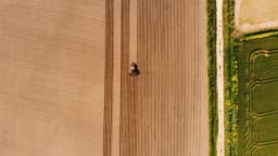 Agricultural Tractor Plowing Field