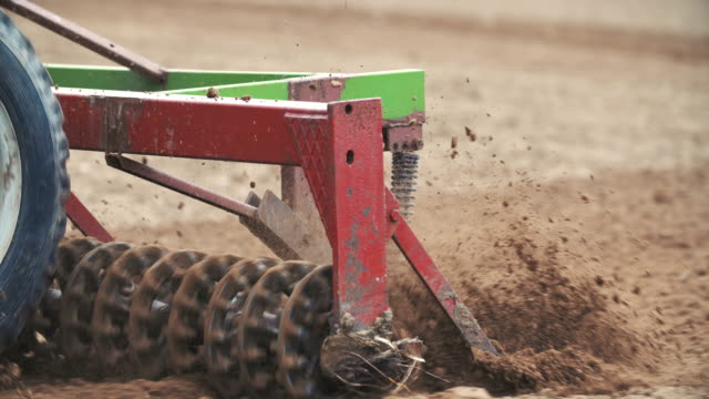 Agricultural tractor sowing field