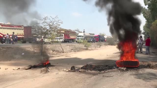 agricultural workers block the panamericana sur with blockades during a strike against low wages and alleged labor mistreatment, blocking thousands... - pan american highway stock videos & royalty-free footage