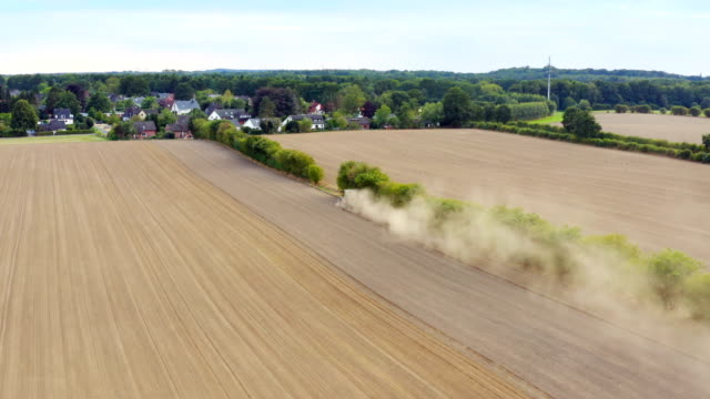 stockvideo's en b-roll-footage met agriculture field aerial view - silo