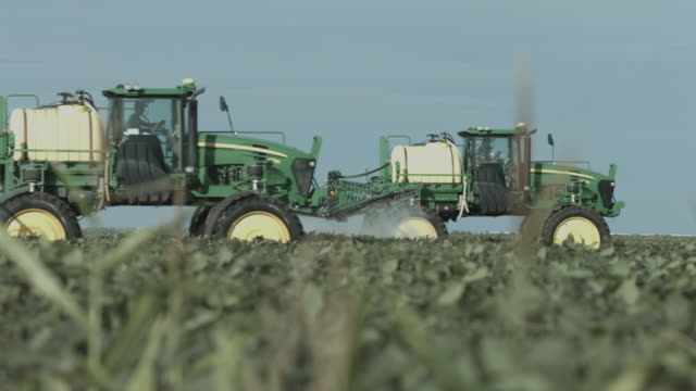 agriculture machines working on soil - insecticide stock videos & royalty-free footage