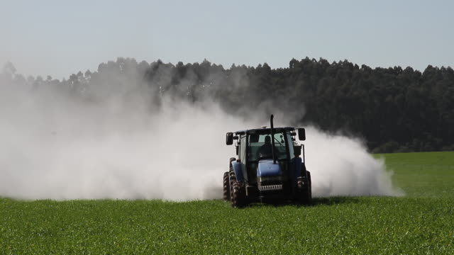agriculture - tractor fixing acidic field 4k - chemical stock videos & royalty-free footage