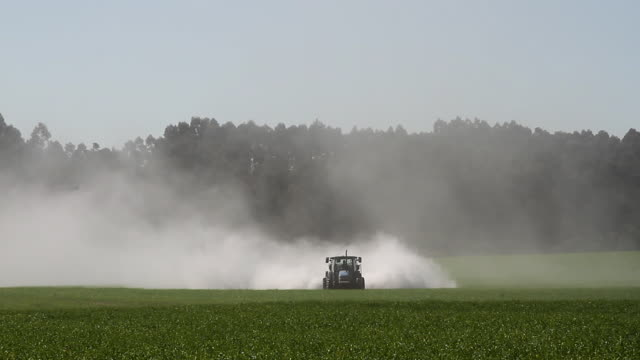 agriculture - tractor fixing acidic field 4k - soybean stock videos & royalty-free footage